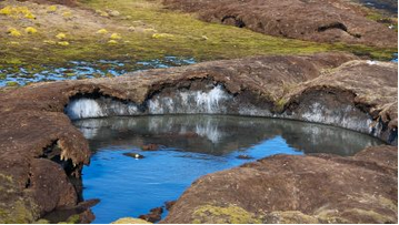 How is melting permafrost affecting communities in the Arctic and beyond?